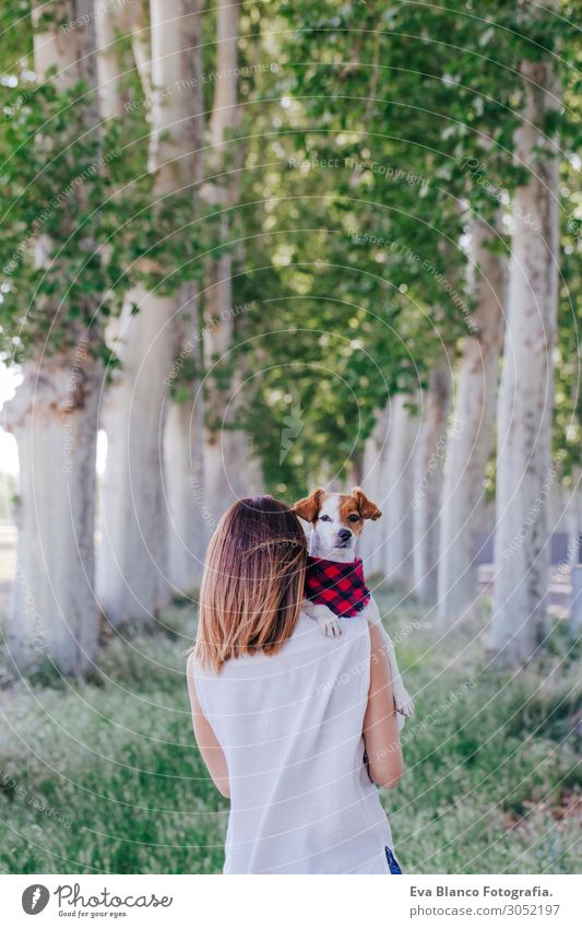 young beautiful woman holding her cute small dog on shoulder Lifestyle Beautiful Harmonious Leisure and hobbies Vacation & Travel Summer Feminine Young woman