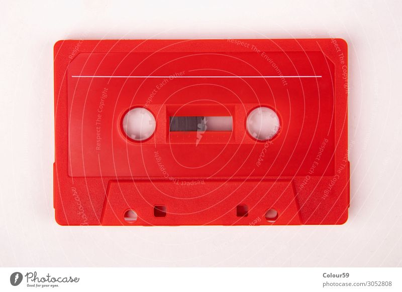 Red music cassette Lifestyle Music Plastic Retro Nostalgia Tape cassette audio Vintage 80s bare analogue dance isolated eighties Disco Background picture label