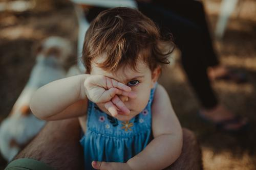 Little girl covering eye with hand Lifestyle Human being Child Baby Toddler Girl 1 1 - 3 years Observe Communicate Looking Happiness Hideous Funny Natural