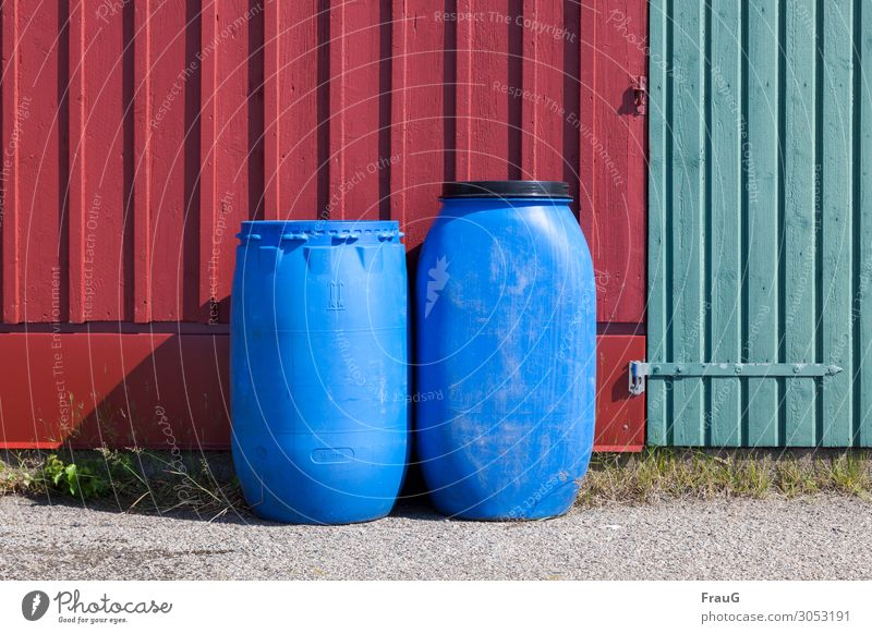 Trapped in plastic. Whatever's inside... Facade Wood Barrels Plastic with lid and without Shadow Deserted Exterior shot Day Green variegated Red Blue