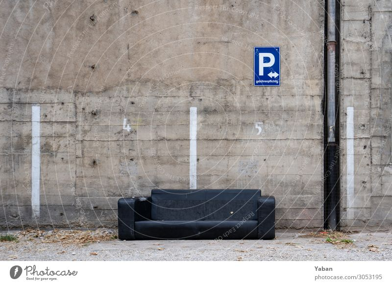 Parked Closing time Living or residing Old Town Gray Black Decline Sofa Bulk rubbish Squander Parking lot Concrete wall Colour photo Exterior shot