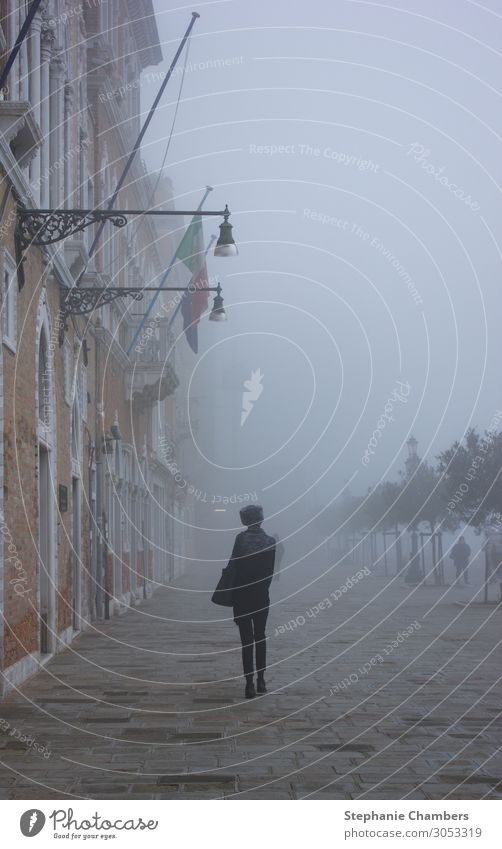 Woman walking through Venice 1 Human being Wanderlust Italy wander Loneliness misty Mysterious atmospheric Colour photo Exterior shot Day Looking away