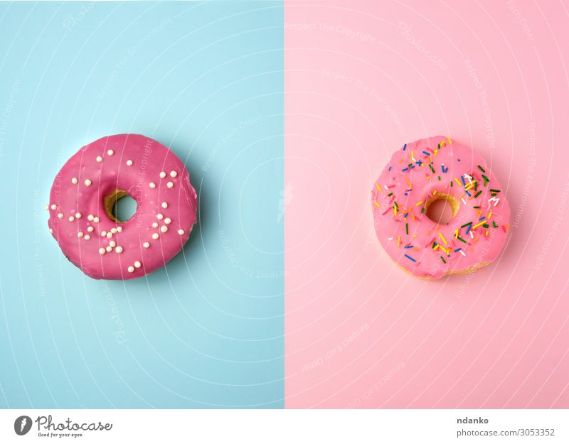 two whole round pink donuts with colored sprinkles Cake Dessert Candy Nutrition Breakfast Decoration Feasts & Celebrations Eating Exceptional Fresh Bright