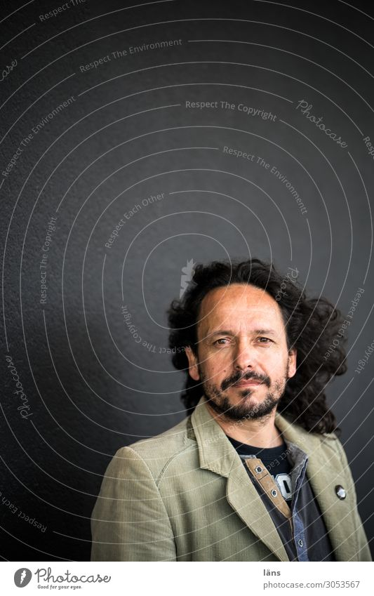 confident man l AST10 Human being Masculine Man Adults Life Wall (barrier) Wall (building) Jacket Long-haired Facial hair Observe Looking Authentic Friendliness