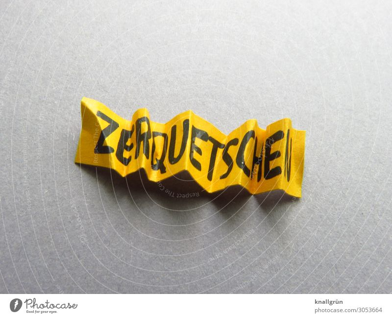 ZERQUEST. Characters Signs and labeling Communicate Yellow Gray Black Aggression Anger Destruction Squash Annihilate squeeze Colour photo Studio shot Deserted