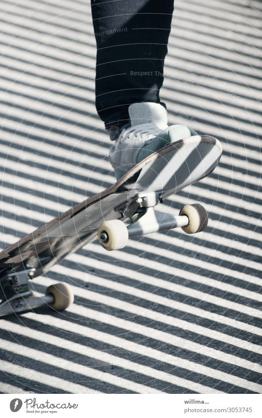 That's pretty weird. in chemnitz Skateboarding skate wheel Roll Feet Sneakers Shadow obliquely Diagonal Stripe Exterior shot Close-up