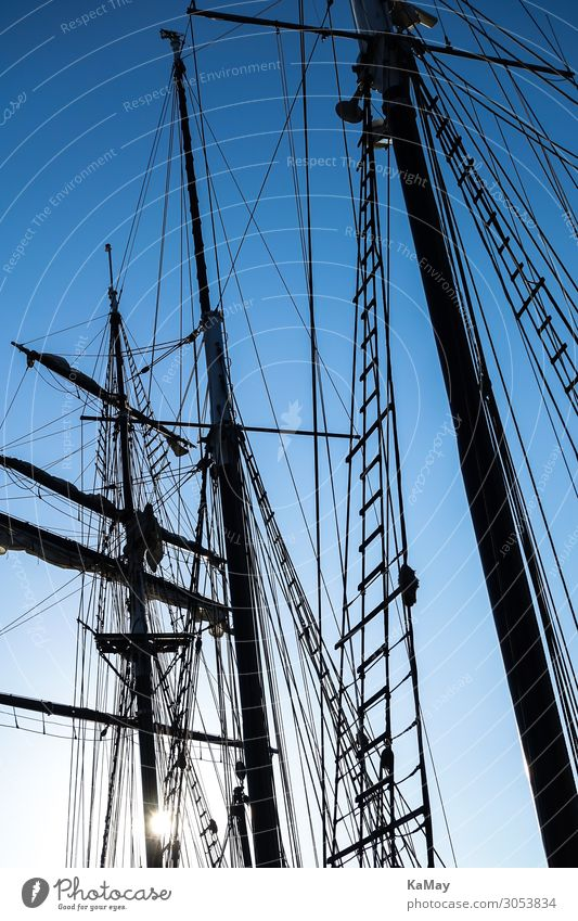 Silhouettes of the masts of a sailing ship Navigation Sailboat Sailing ship Maritime Blue Black Movement Freedom Leisure and hobbies Climate Vacation & Travel