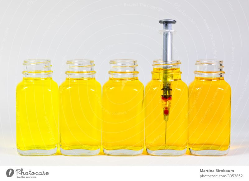 Bottles with yellow serum and a injection needle, syringe Old Colour White Yellow Natural Brown Fruit Fresh Industry Delicious Medication Diet Fluid