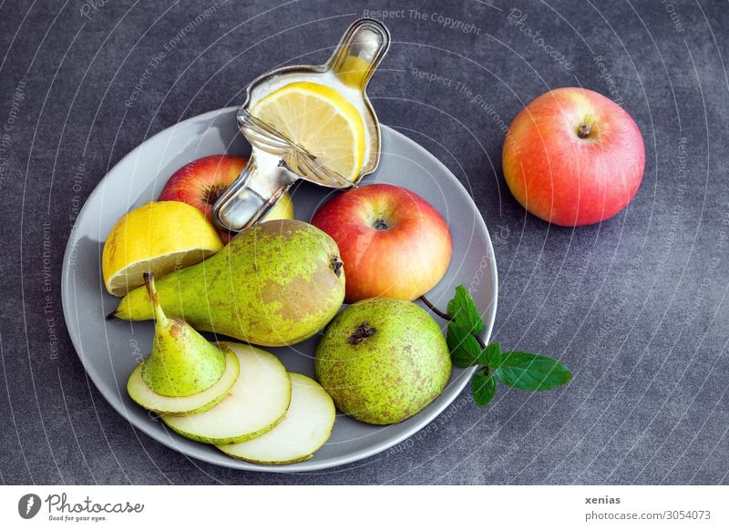 Fruit plate with pear, apple and lemon Food Apple Pear Lemon Mint Nutrition Organic produce Vegetarian diet Diet Plate Lifestyle Healthy Eating Fresh Juicy Sour