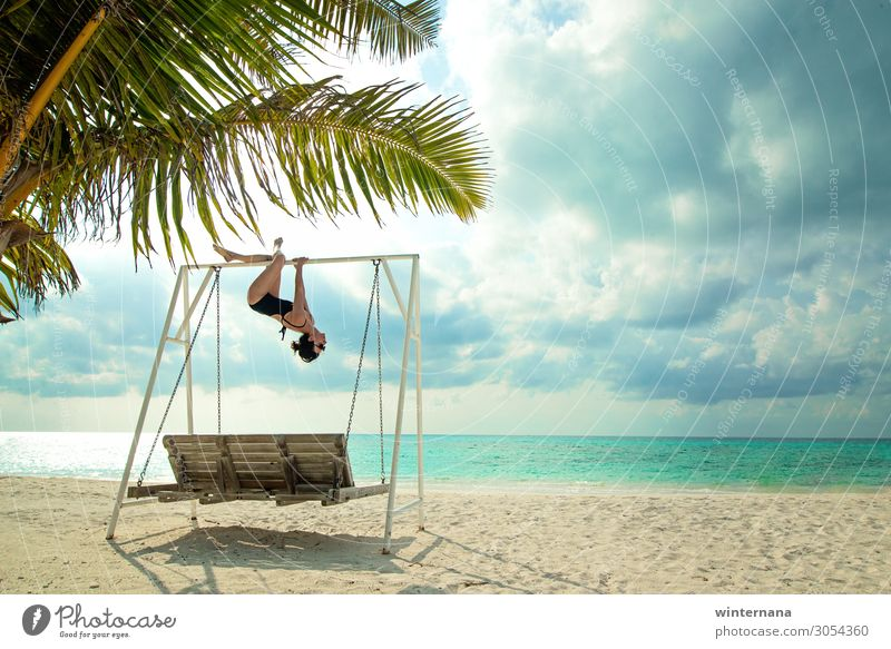 Hanging on a swing ocean Palm tree sky clouds Vacation & Travel maldives holiday sand beach swimsuit sunglasses