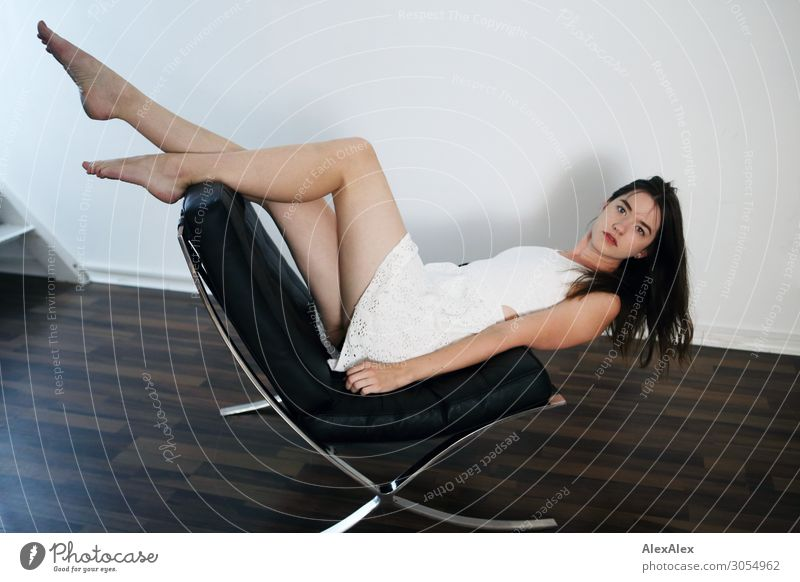 Young woman lying upside down on an armchair Lifestyle Style Joy Beautiful Living or residing Armchair Youth (Young adults) Legs Feet 18 - 30 years Adults Dress