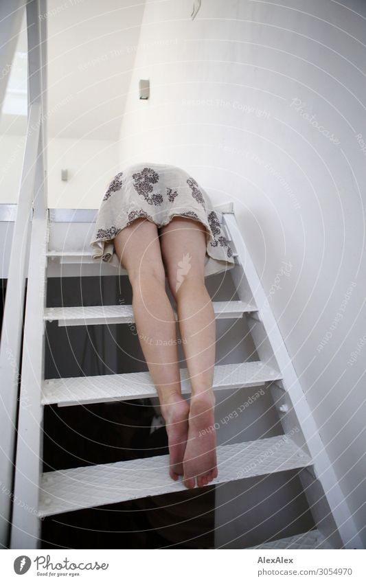 Young woman lying on a steel staircase Joy Beautiful Life Room Stairs Youth (Young adults) Legs Feet 18 - 30 years Adults Dress Barefoot Steel Lie Esthetic