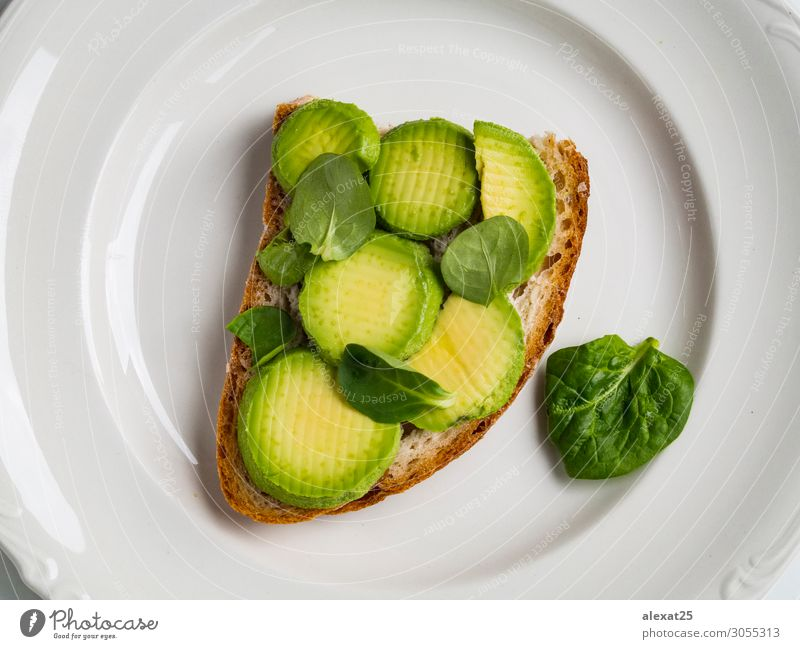 Avocado toast in a plate Vegetable Fruit Bread Nutrition Breakfast Lunch Vegetarian diet Fresh Natural Green appetizer avocado background brunch food Gourmet