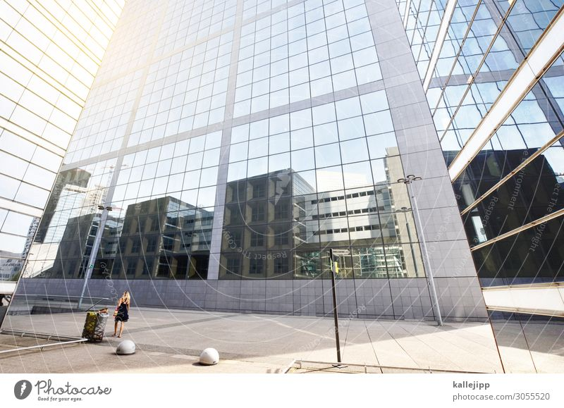 Woman Human being Town Architecture Lifestyle Wall (building) Cold Feminine Business Building Wall (barrier) Stone High-rise Elegant Glass Manmade structures