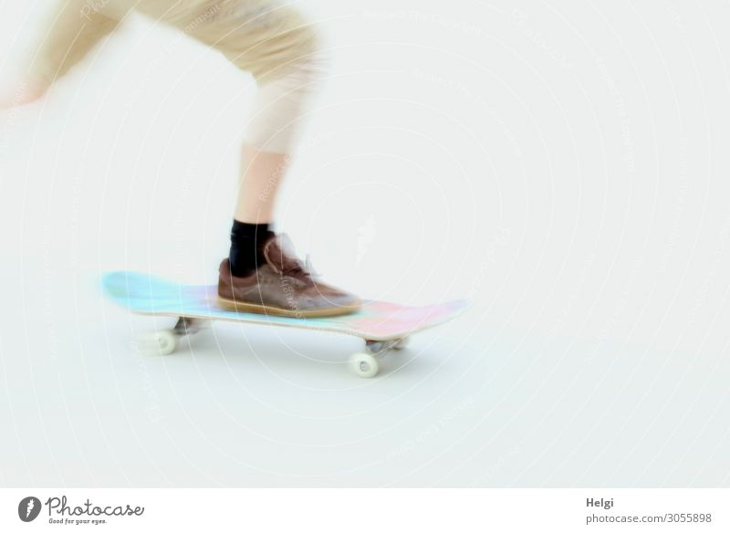 Detail of a scateboarder with motion blur Sports Skateboard Sports ground Human being Legs Feet 1 18 - 30 years Youth (Young adults) Adults Clothing Pants
