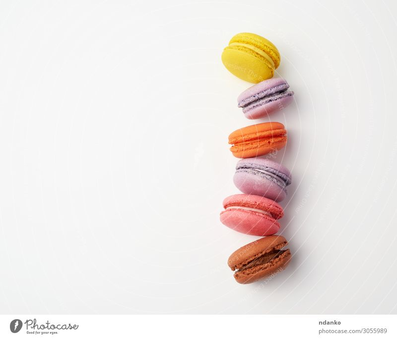 stack of colorful baked macaron Cake Dessert Candy Eating Fresh Delicious Above Brown Yellow Pink White Colour Tradition Stack Vanilla choice Almond Sugar cream