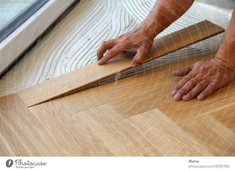 Craftsman lays parquet flooring Parquet floor Ground Floor covering Sheepish Installations Construction site Working man Joiner Craftsperson Laminate Panels