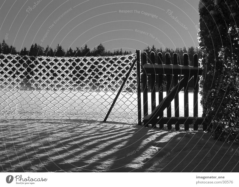 0005 Fence Light Shadow Snow Ice Black & white photo