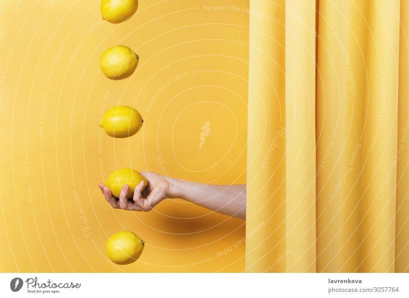 woman's hand holding a lemon Fingers Diet Vitamin C Lemon Cloth drapery Concepts &  Topics levitation Curtain Citrus fruits Fruit Summer Fresh Food