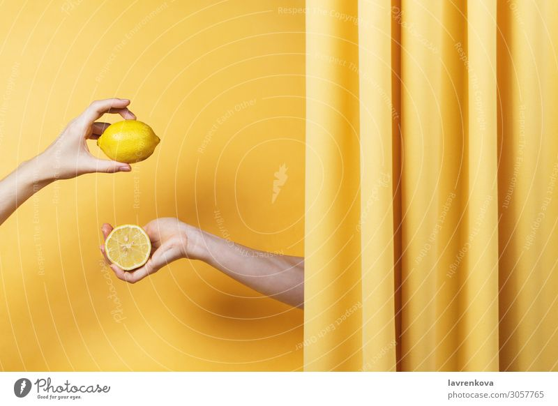 Two women's hands holding cut and whole lemons Natural Yellow Fingers Hold Hand Healthy Healthy Eating Vitamin C Lemon Citrus fruits Fruit Conceptual design