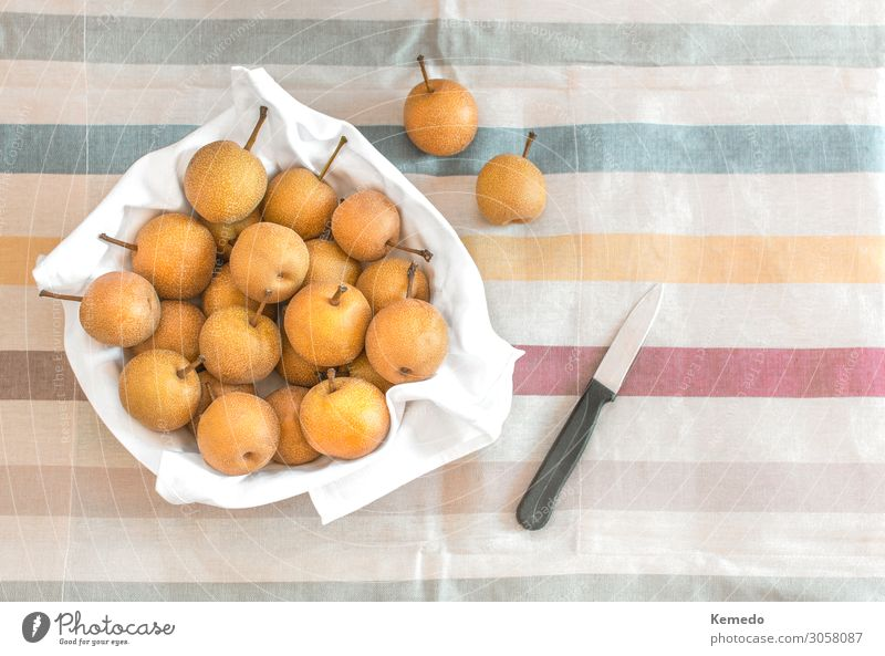 Asian or Nashi pear in a bowl on a colorful tablecloth. Nature Healthy Eating Summer Plant Colour Beautiful Landscape Sun Relaxation Food Lifestyle Environment