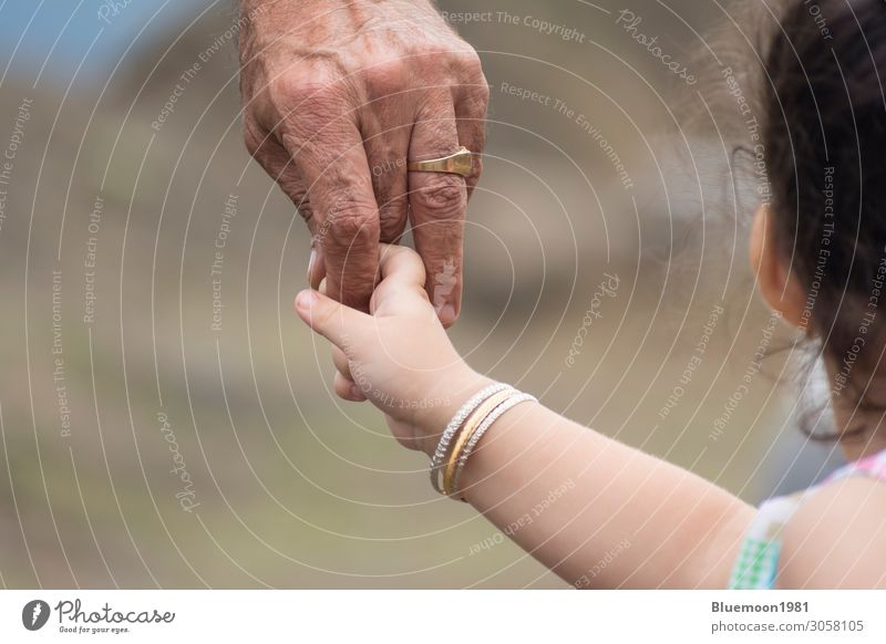 Close-up shot of a child's hand holding finger of his father Child Human being Vacation & Travel Man Old Hand Joy Girl Healthy Lifestyle Adults Love Emotions
