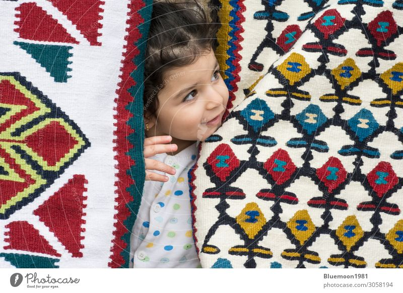 Little girl close up portrait between kilims patterns Child Human being Old Colour Beautiful White Loneliness Healthy Interior design Feminine Happy Style Small