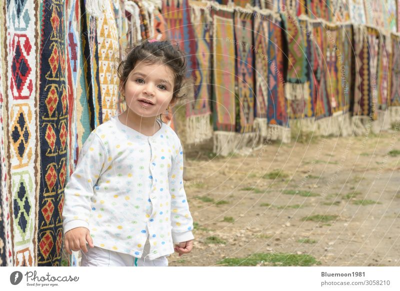 Little girl portrait in front of colorful kilims Child Human being Vacation & Travel Town Colour Beautiful White Loneliness Joy Girl Healthy Lifestyle Emotions