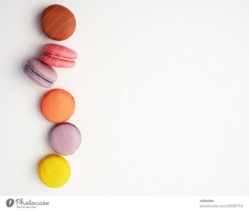 stack of colorful baked macaron almond flour Fruit Dessert Eating Fresh Delicious Above Brown Yellow Pink White Colour Tradition Almond assorted assortment