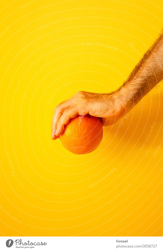 orange in hand on yellow wall II Fruit Lifestyle Design Human being Man Adults Arm Hand Fingers Nature To enjoy Fresh Yellow Colour people Illustration