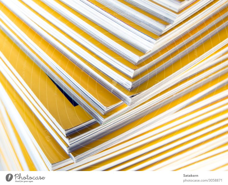 Stack of yellow monthly magazine Relaxation Reading Book Library Paper Piece of paper Collection New Yellow White Colour Accumulation background education Press