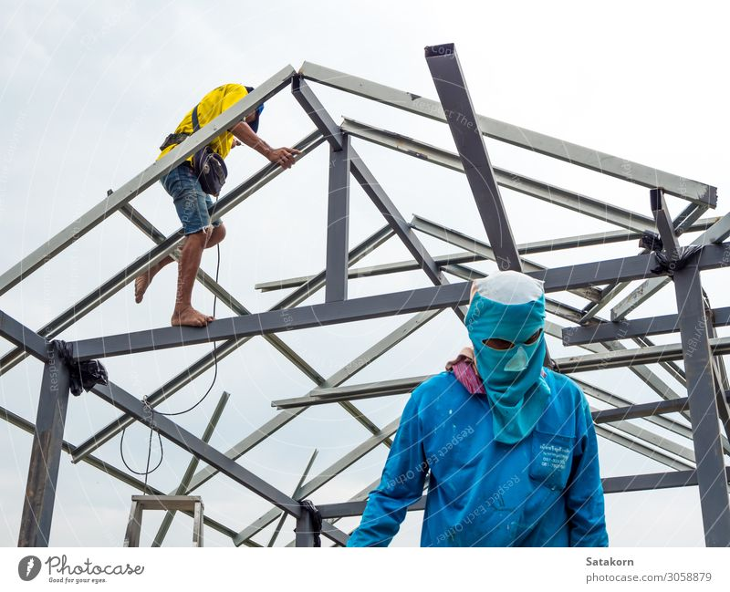 Workers working in the construction site to build a house House building Work and employment Construction site Tool Man Adults Body Head 2 Human being