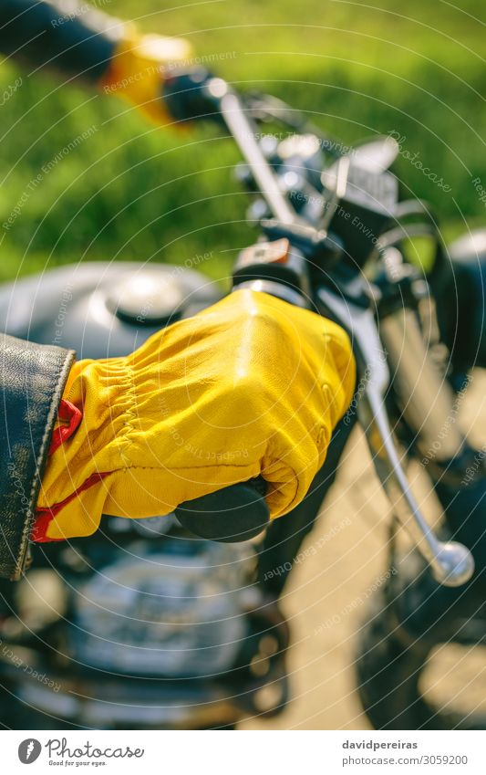 Biker's hand with gloves grabbing the handlebar Lifestyle Engines Human being Man Adults Hand Grass Transport Street Vehicle Motorcycle Gloves Authentic Retro