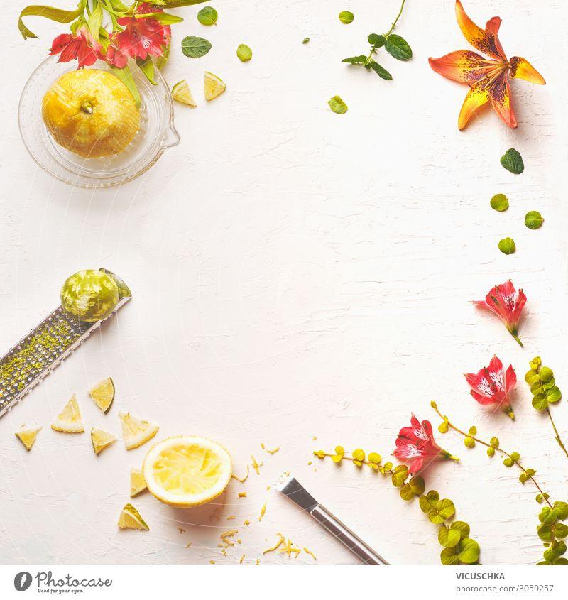 Lemon juice, lemon peel and flower frame Food Fruit Nutrition Beverage Juice Crockery Style Design Healthy Eating Yellow food background flowers top view