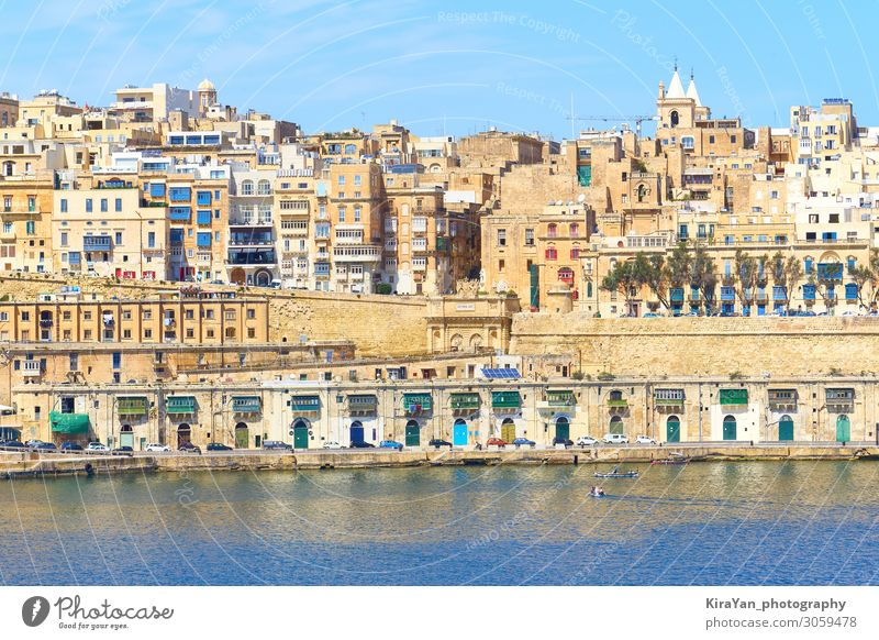 General view of ancient Valletta waterfront with Victoria Gate from water point malta valetta valletta victoria gate grand harbour architecture blue boat