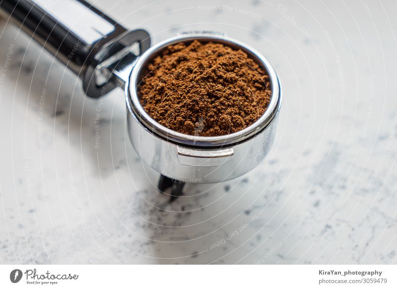 Closeup view of portafilter with ground coffee for coffee machine barista appliance aroma background beans beverage black breakfast brown cafe caffeine