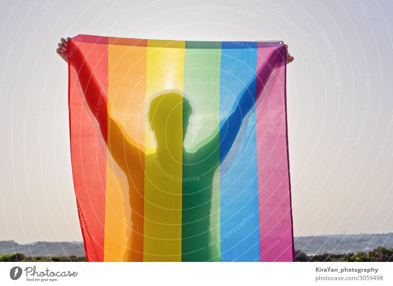 Young woman with LGBT flag Lifestyle Joy Freedom Feasts & Celebrations Homosexual Woman Adults Body Hand 1 Human being Summer Flag Love Sex Bright Relationship