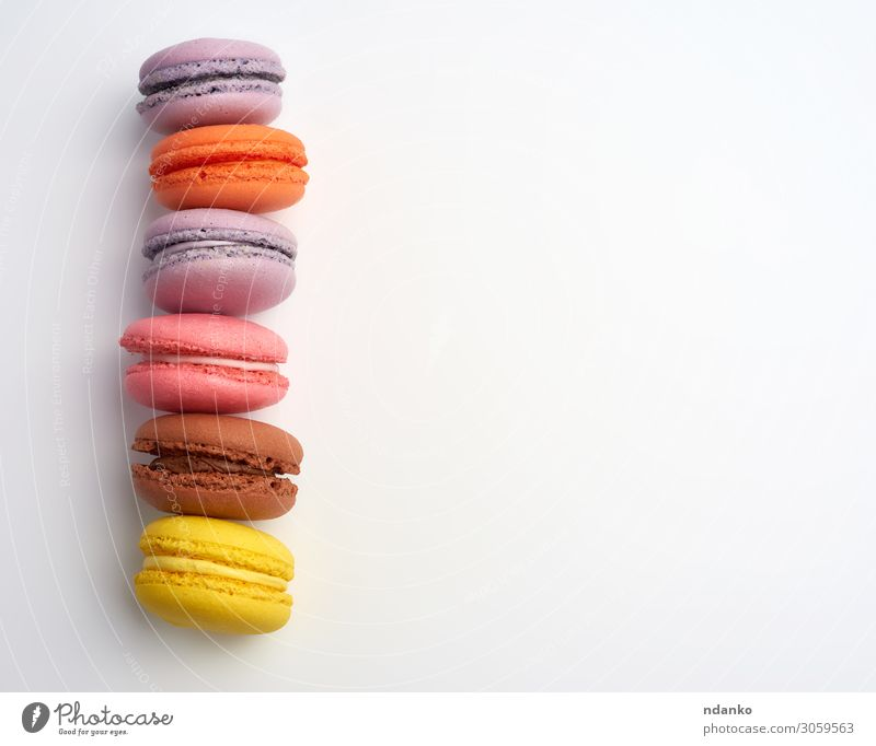 colorful baked macarons almond flour Cake Dessert Candy Nutrition Eating Fresh Delicious Above Brown Yellow Pink White Colour Tradition Almond assorted