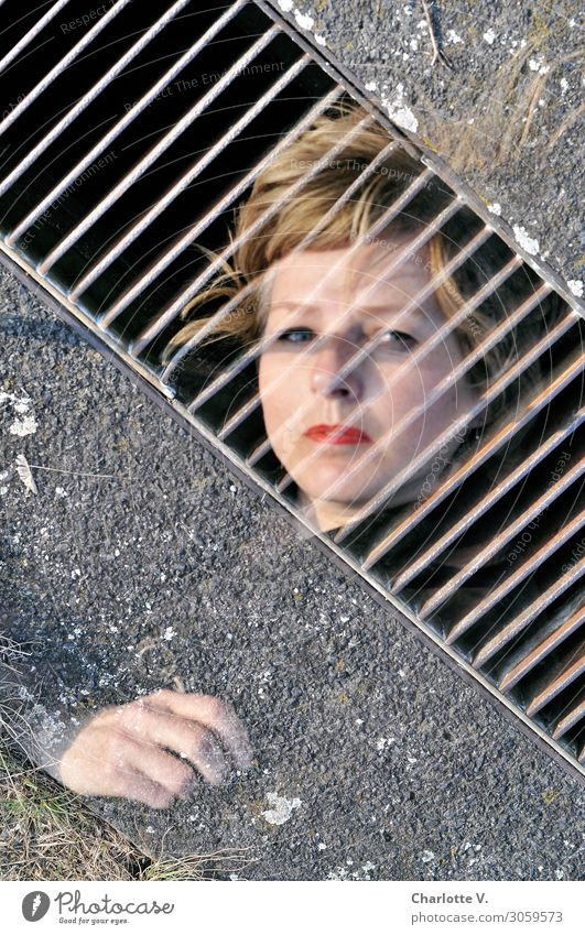 behind bars Feminine Woman Adults Face Hand 1 Human being 45 - 60 years Drainage Blonde Concrete Metal Observe Touch To fall To hold on Sadness Exceptional