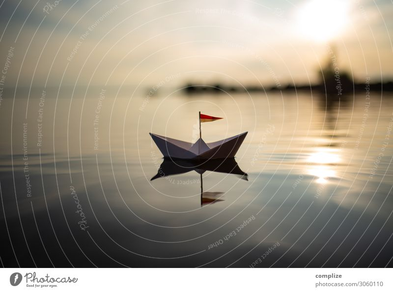 Smooth sailing . Paper boat on a lake voyage peaceful... tranquillity Wellness relaxation vacation Peaceful Lake Water Beach Harbour ship +sailboat Sailing