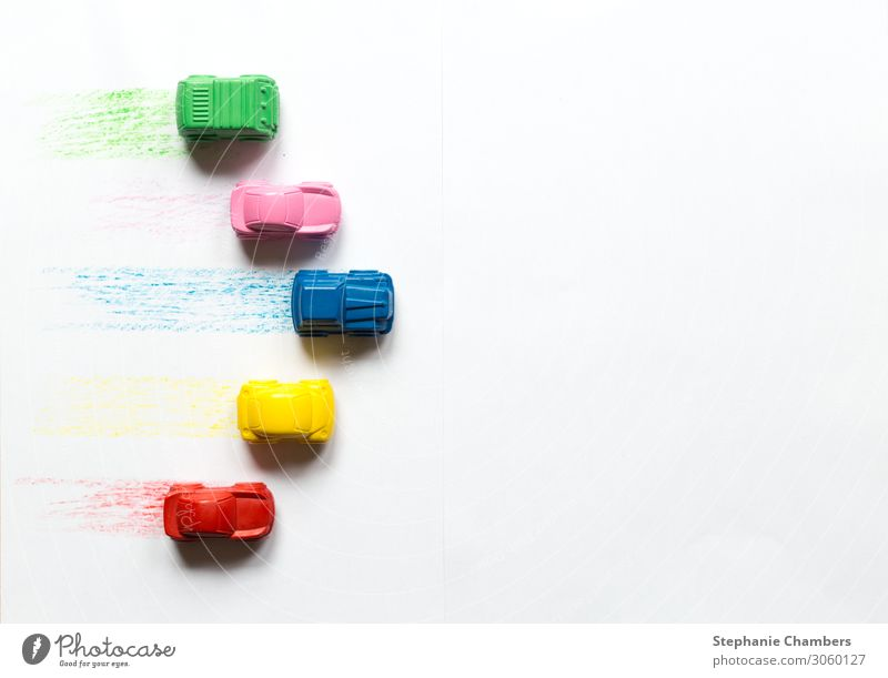 Five coloured crayon cars on a white background Car Multicoloured Motor vehicle back to school flatlay Crayon Racing car Zoom in/out travel Colour photo