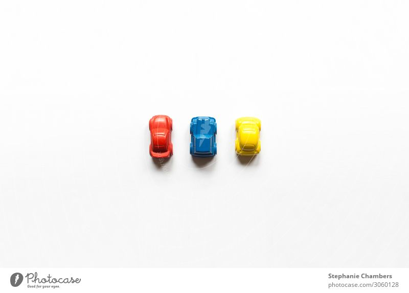 A red, blue and yellow crayon car flat lay. Car Blue Yellow Red Motor vehicle colourful flatlay primary colours Crayon back to school Colour photo