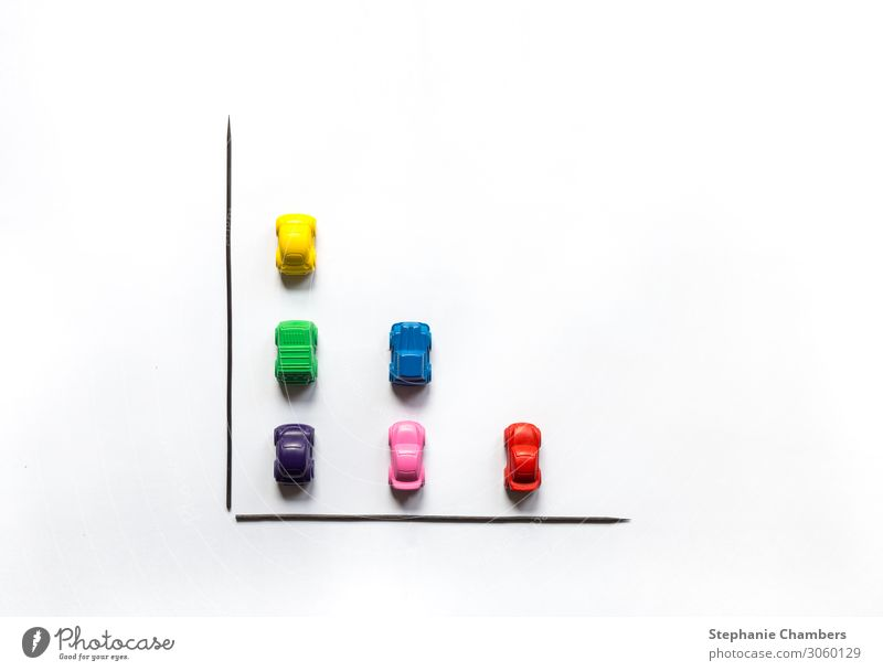 Coloured crayon cars in a bar chart flat lay. Car Multicoloured Motor vehicle colourful flatlay Graph Chart Data Crayon Colour photo