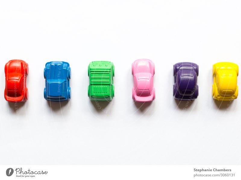 Six coloured crayon cars horizontally aligned. Car Multicoloured Motor vehicle colourful flatlay Colour back to school Colour photo