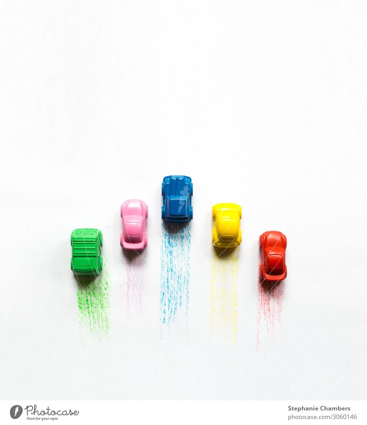 Five coloured crayon cars with colour trails. Car Multicoloured Motor vehicle colourful flatlay Zoom effect Crayon Colour photo