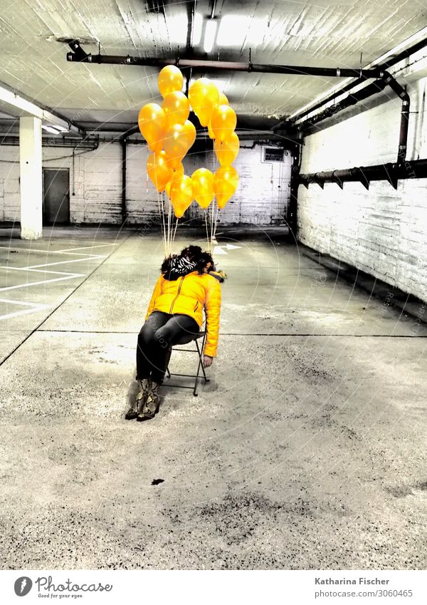 yellow balloons 1 Human being Parking garage Signs and labeling Sit Yellow Gold Gray Black White Exhaustion Chair Balloon Garage Woman Boots Denim Colour photo