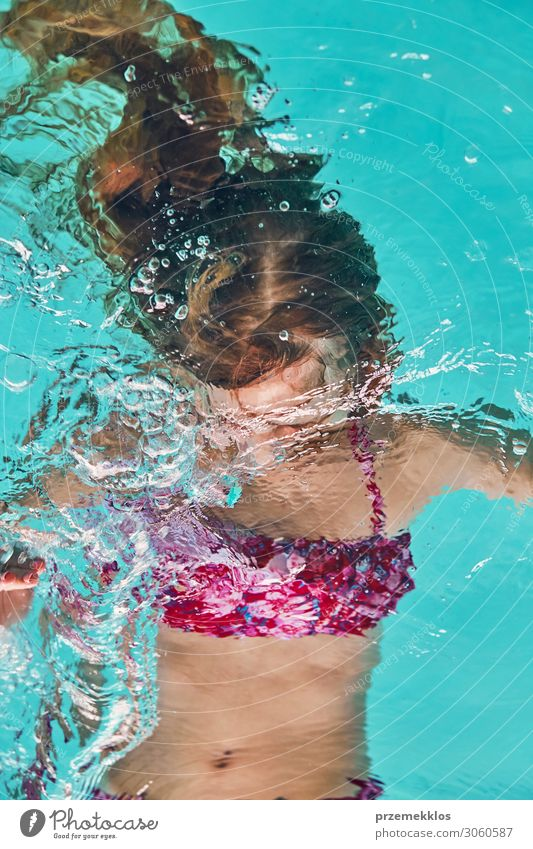 Young woman immersing herself in water Woman Child Human being Vacation & Travel Youth (Young adults) Summer Blue Beautiful Relaxation Joy Lifestyle Adults