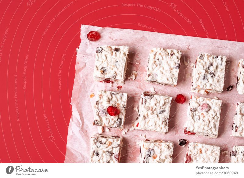 Christmas cake on a red background. Dessert Candy Happy Winter New Year's Eve Red White Tradition Australian Candied fruit Xmas cookies above view Bakery
