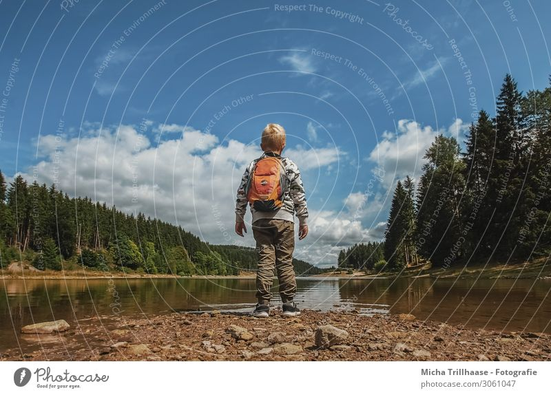 Child Human being Sky Vacation & Travel Nature Blue Green Water Landscape Clouds Forest Yellow Boy (child) Tourism Orange Hiking
