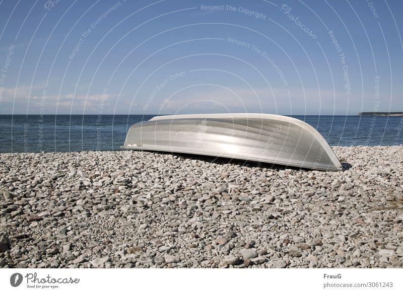 Aluminum boat on the stone beach Ocean Baltic Sea Beach coast Stones on the beach stones Limestones Aluminium Metal Summer Sky Clouds